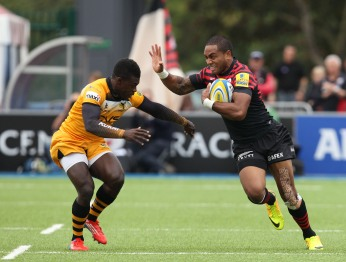 Michael Tagicakibau of Saracens takes on Christian Wade of Wasps. Saracens v London Wasps, Aviva Premiership, Rugby Union, Allianz Park, 05/10/2013 © Matthew Impey/Wiredphotos.co.uk. tel: 07789 130 347 email: matt@wiredphotos.co.uk